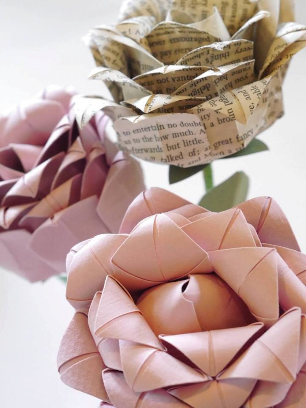 Pink and book page origami flower bouquet, by the origami boutique.