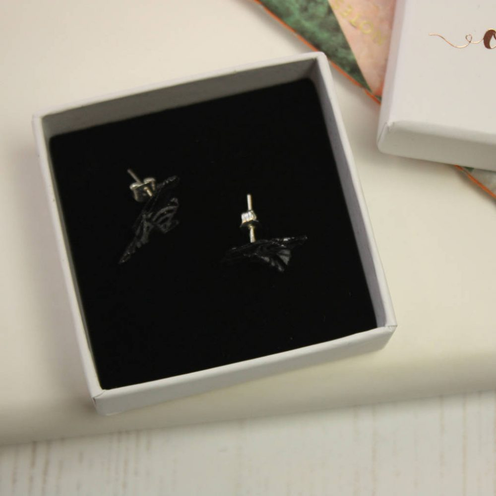 Hand folded origami bird earrings, in black and silver waves, delivered in gold foil gift box. Hand made by the Origami Boutique in London.