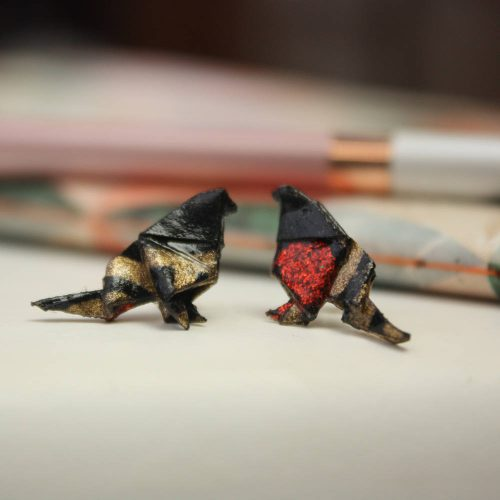 Origami bird earrings, in black, gold and metallic red. Small and comfortable to wear, handmade in london by the Origami boutique.
