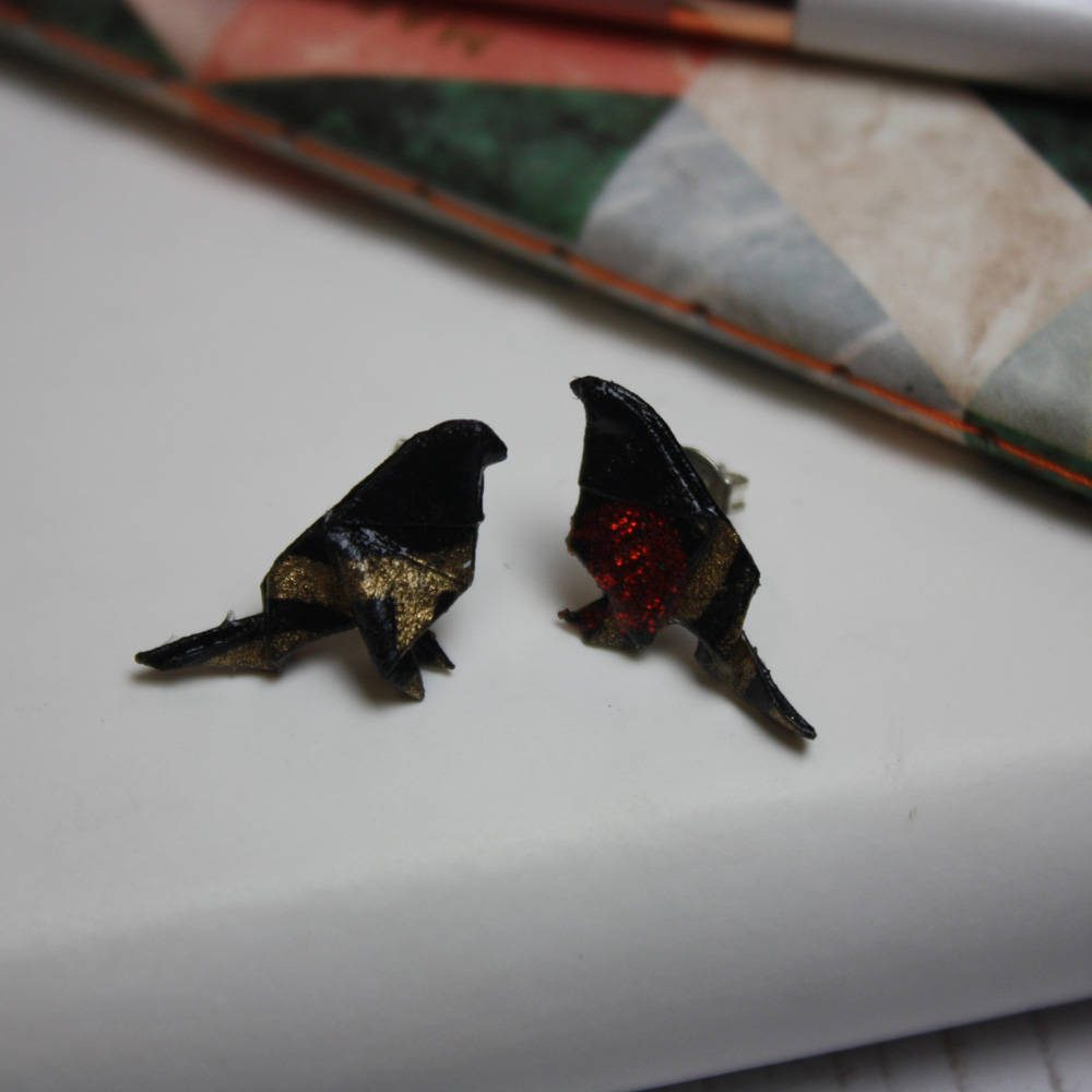 Bird earrings, hand folded from water resistant paper, at the origami boutique.
