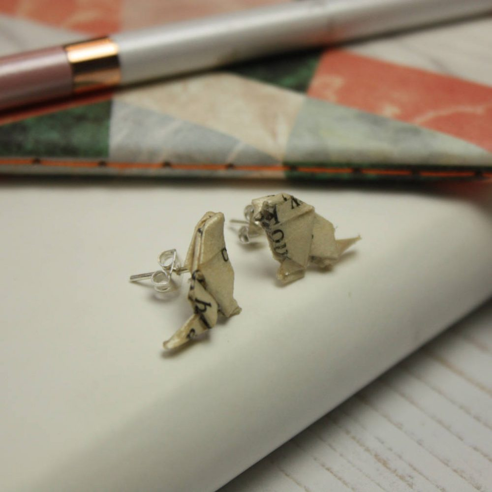 Side view of bird origami earrings, in book pages. Hand folded by the Origami Boutique, London.