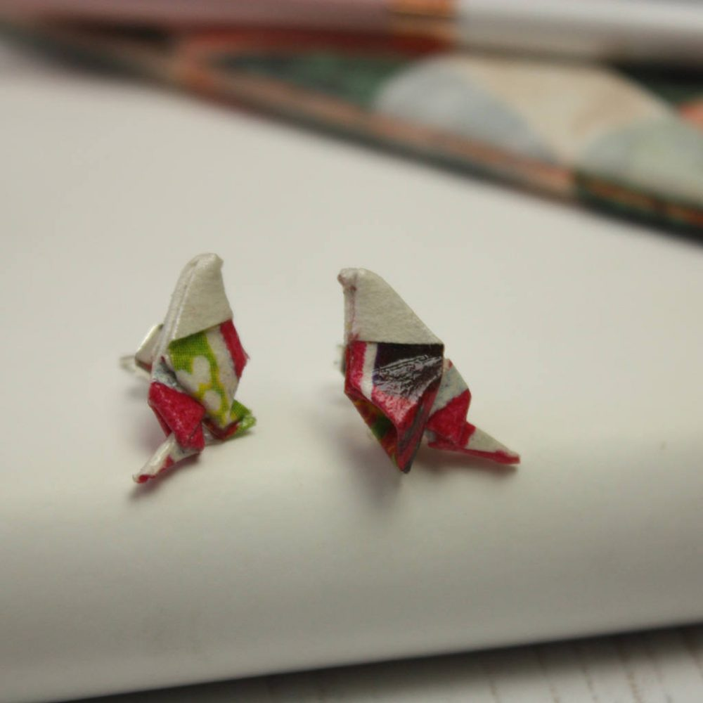 Close up of paper bird earrings, folded by the origami boutique, London.