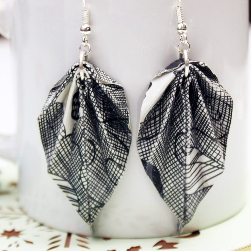 Black and white origami earrings. Lightweight leaves makes for comfortable jewellery. Handmade jewellery by the origami boutique.