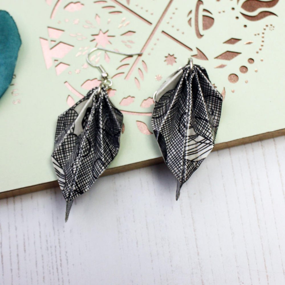 Black and white origami leaf earrings. Comfortable water resistant jewellery. Handmade by the origami boutique.