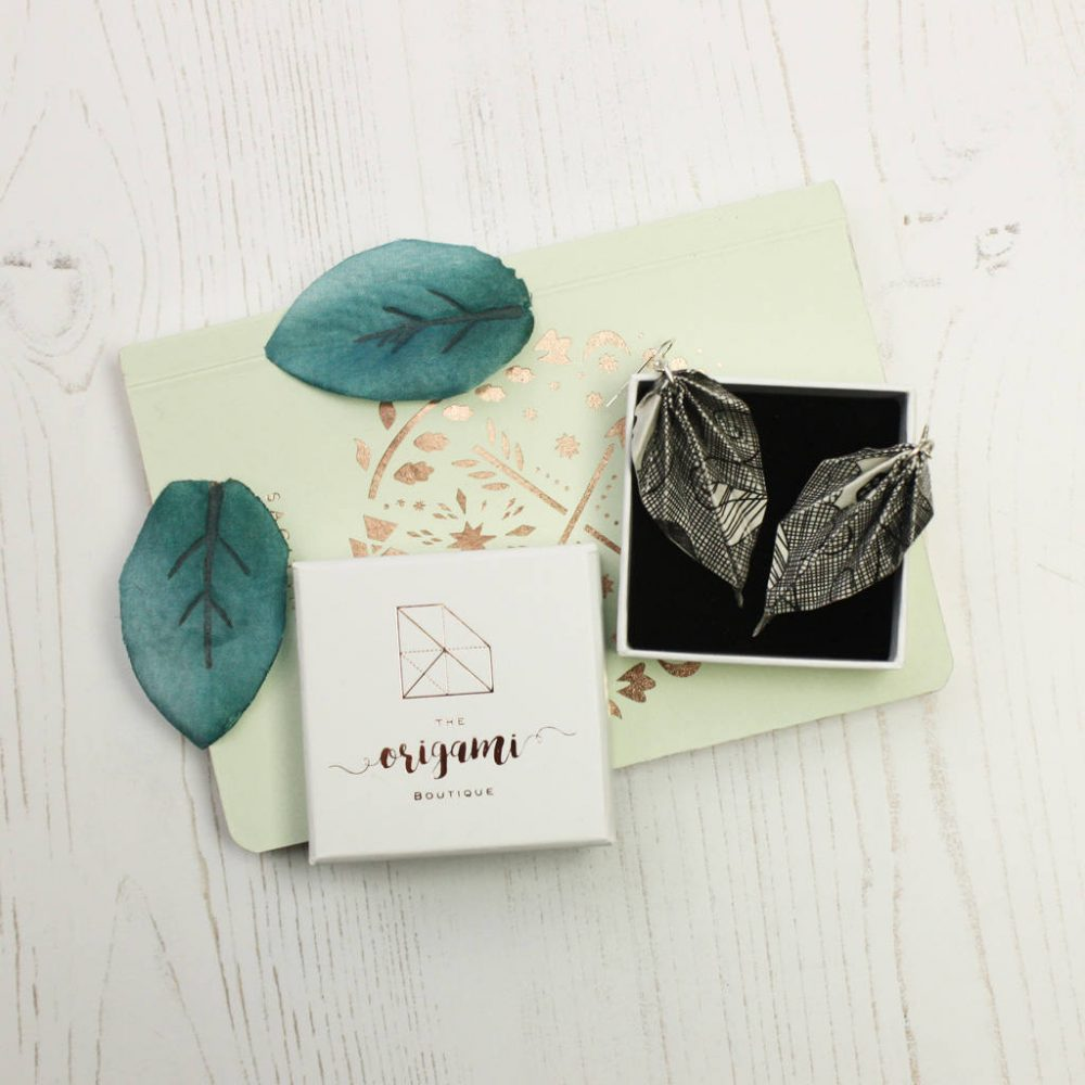 Scraffito origami leaf earrings, in white jewellery box. Handmade by the origami boutique.
