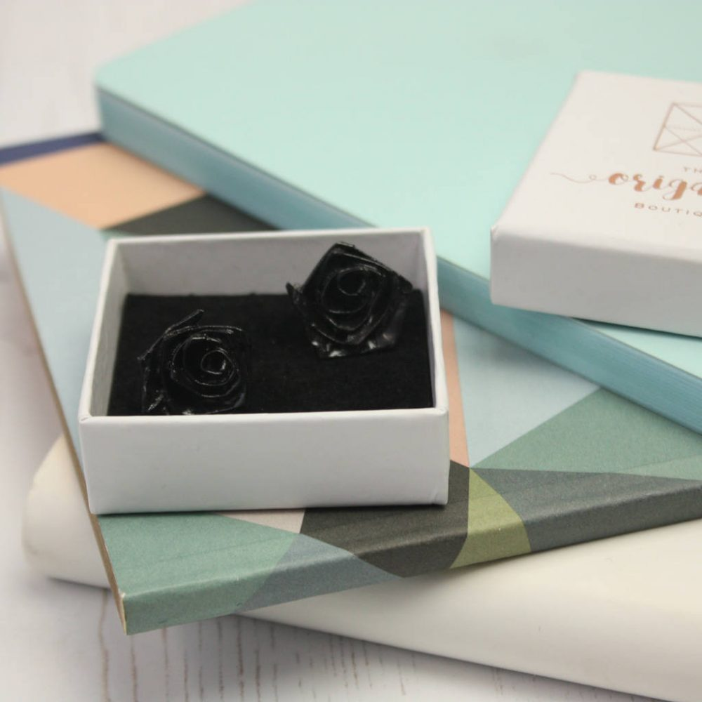 Black earrings, hand folded from water resistant paper, at the origami boutique, in gift box.