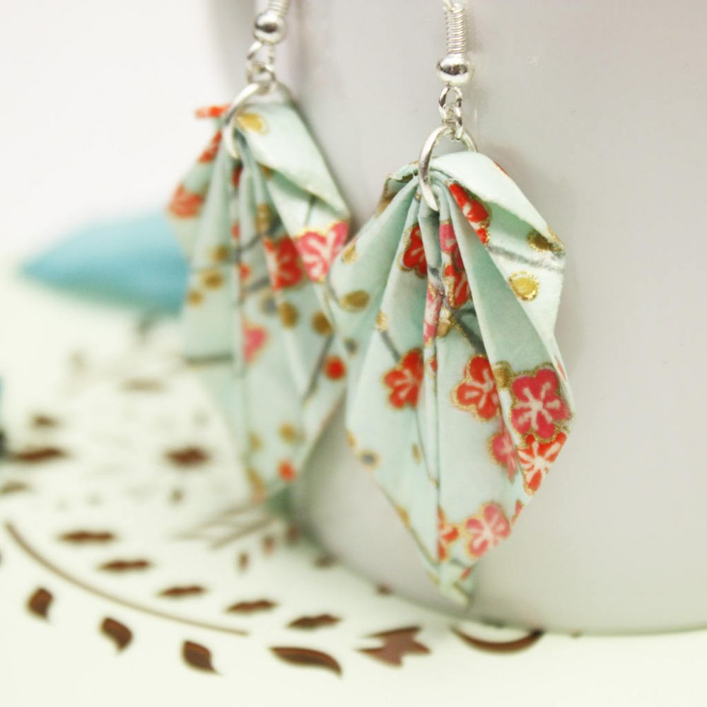 Close up of spring orange blossom leaf earrings, leight weight origami jewellery, by the origami boutique.