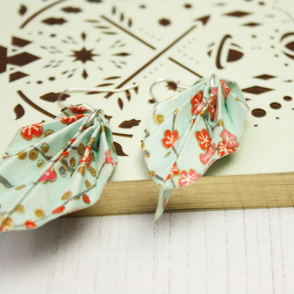 Close up spring orange blossom leaf earrings, leight weight origami jewellery, by the origami boutique.