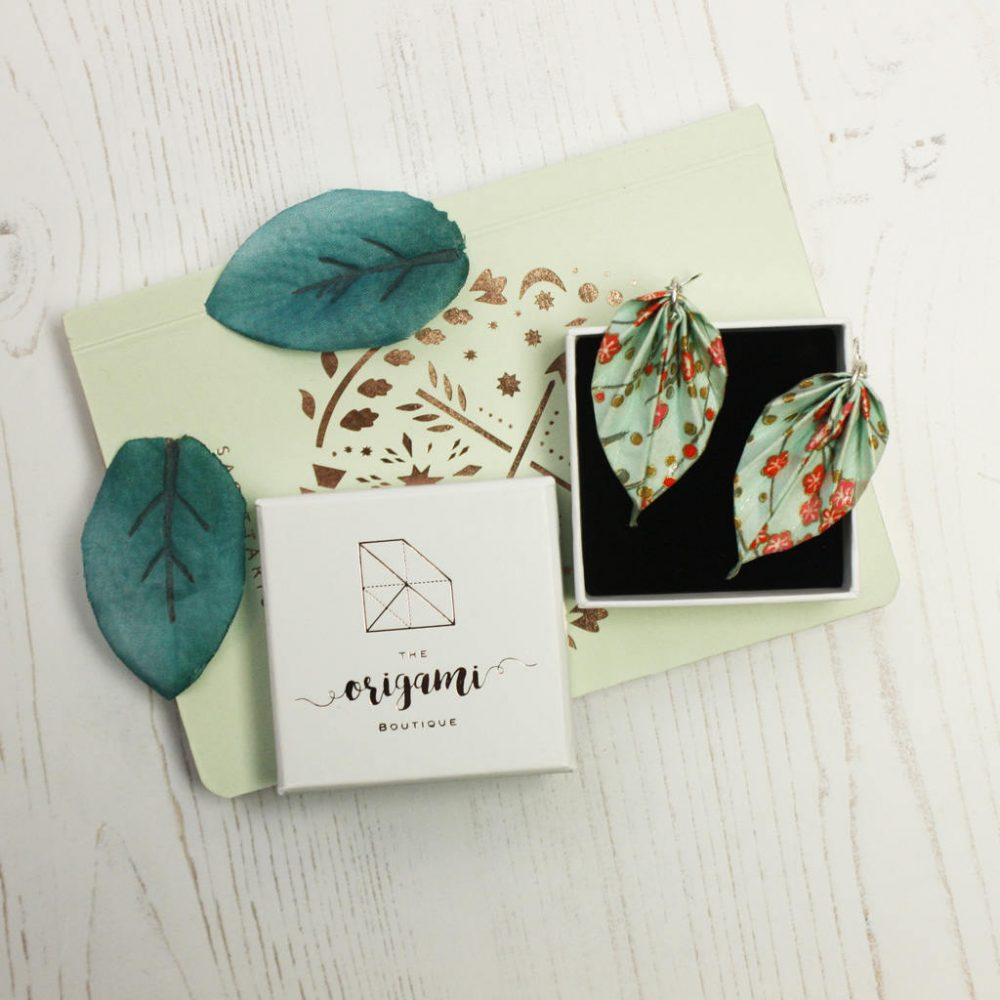 White box with blossom leaf earrings.