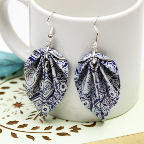 Blue tiles hanging leaf earrings, by the origami boutique, London.