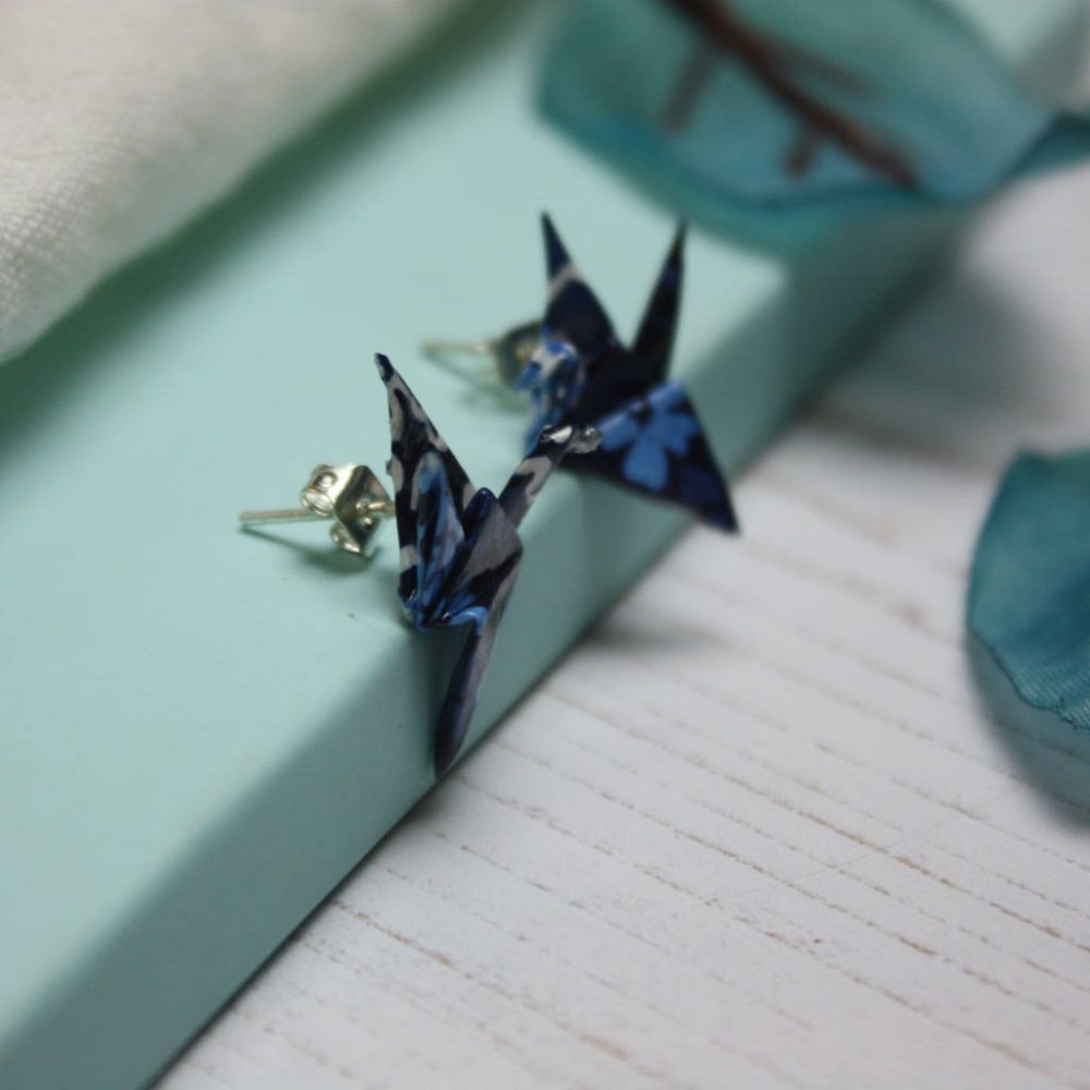 Side view of blue patchwork, origami, crane earrings. Handfolded stud earrings, by the origami boutique.