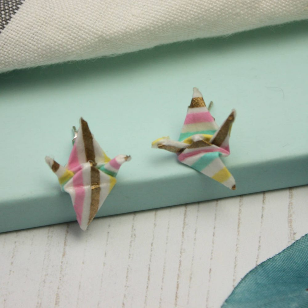 Close up of origami crane earring. Handmade by the origami boutique.