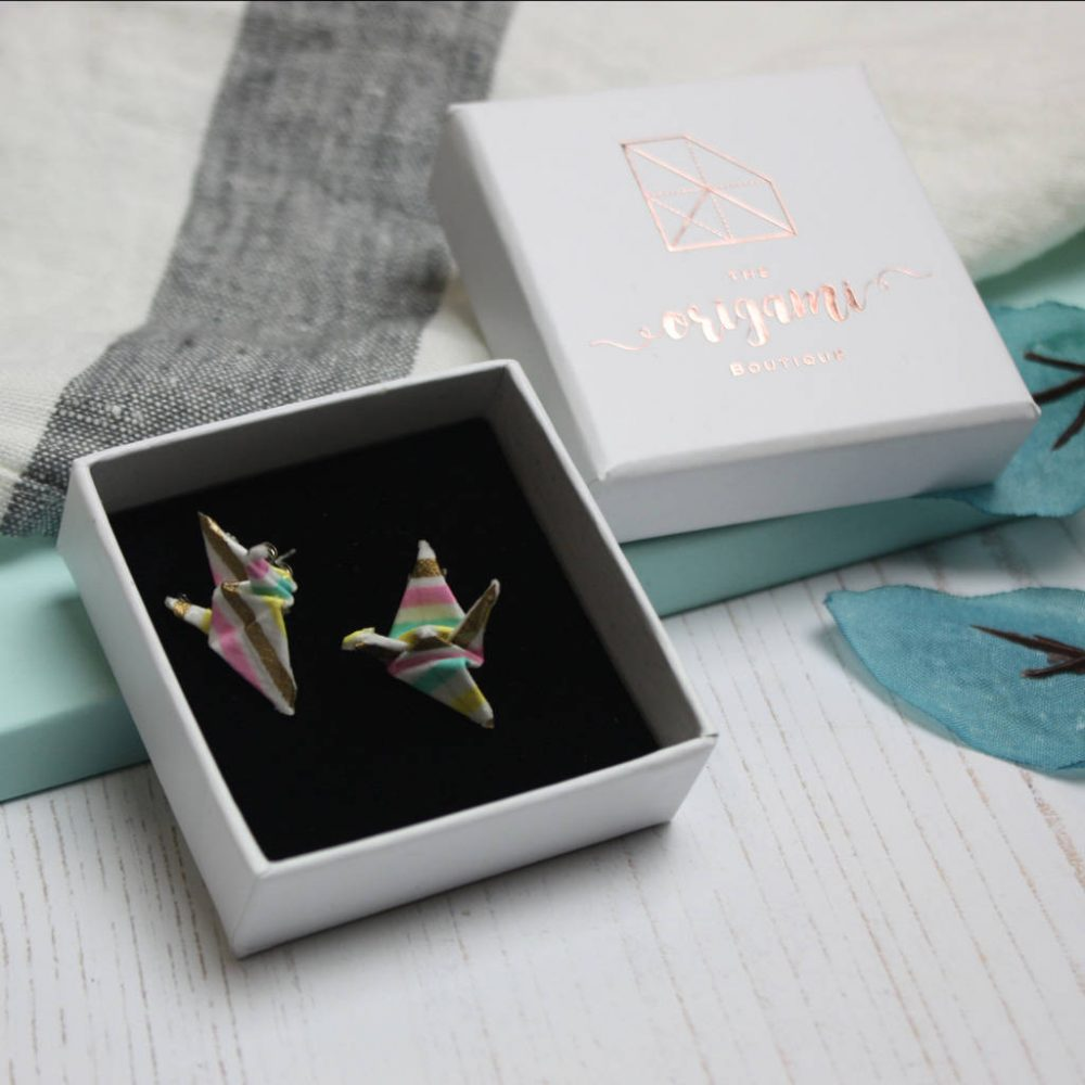 Close up of origami crane earrings, in gift box. Handmade by the origami boutique.