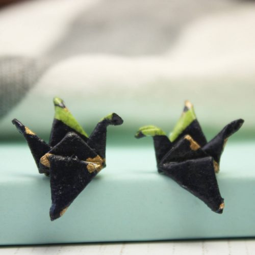Navy knit crane earrings close up. By the origami boutique, London.