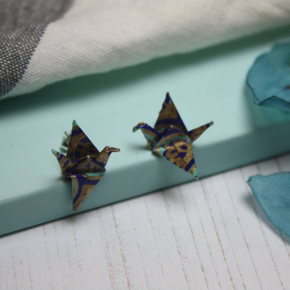 Water resistant origami crane earings, in blues and gold, by the origami boutique.