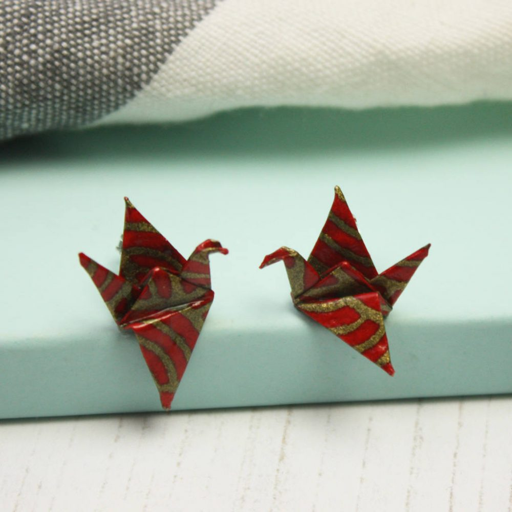 Origami crane jewellery, in red and gold, from the origami boutique.