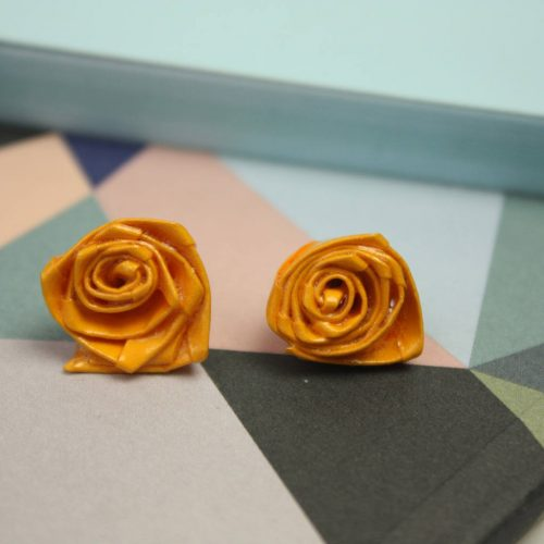 Deep yellow water resistant paper flower earrings. Handmade by the origami boutique, London.