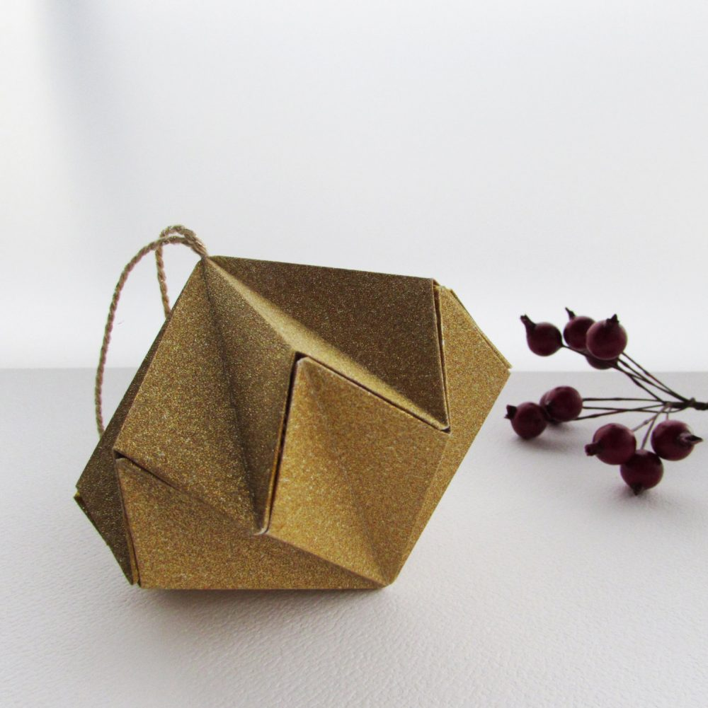 Gold glitter hanging ornament. Origami hand folded by the origami boutique, London.