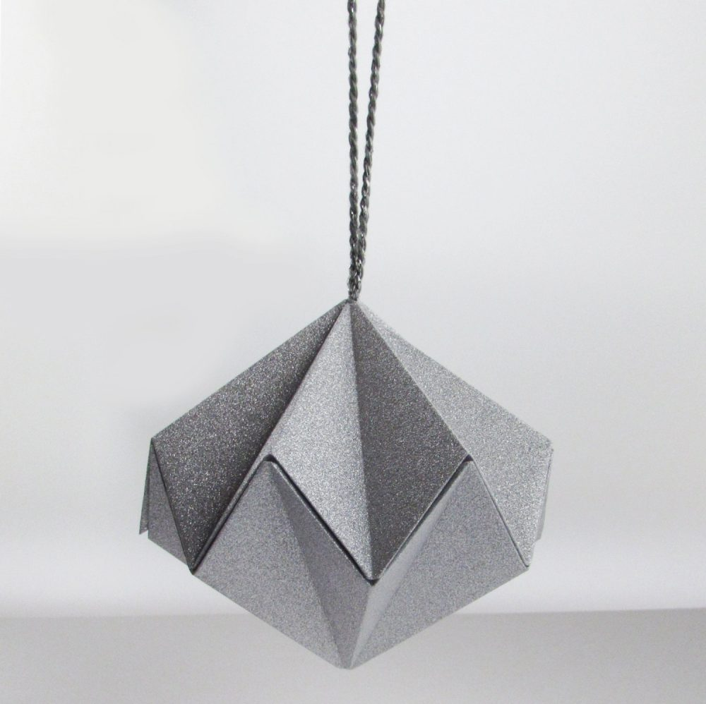 Metallic silver hanging ornament. Handmade by the origami boutique, London.