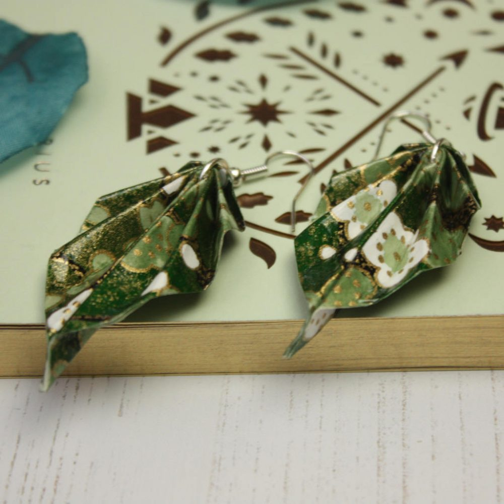 Close up with green foliage origami hanging leaf earrings.