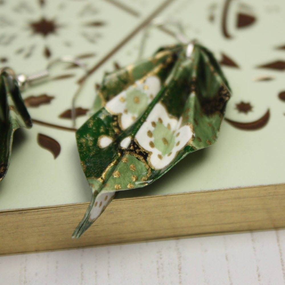 Close of of Green foliage origami hanging leaf earrings. Handmade by the origami boutique.