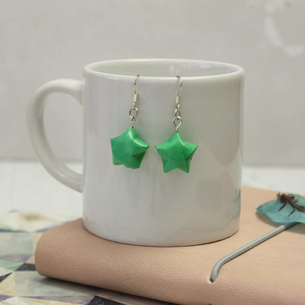Hanging green star earrings, handmade by the origami boutique.
