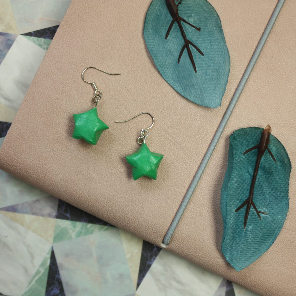 Hanging green origami star earrings. By the Origami boutique, London.