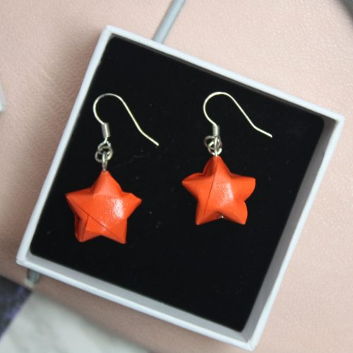 Hanging Orange star earrings. Water resistant origami jewellery, by the origami boutique, ,london.