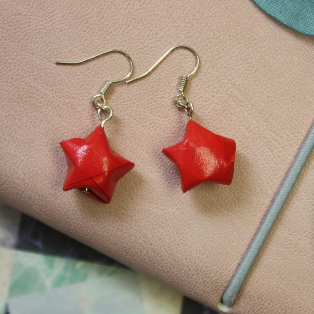 Hanging red star earrings. hand folded by the origami boutique, London.