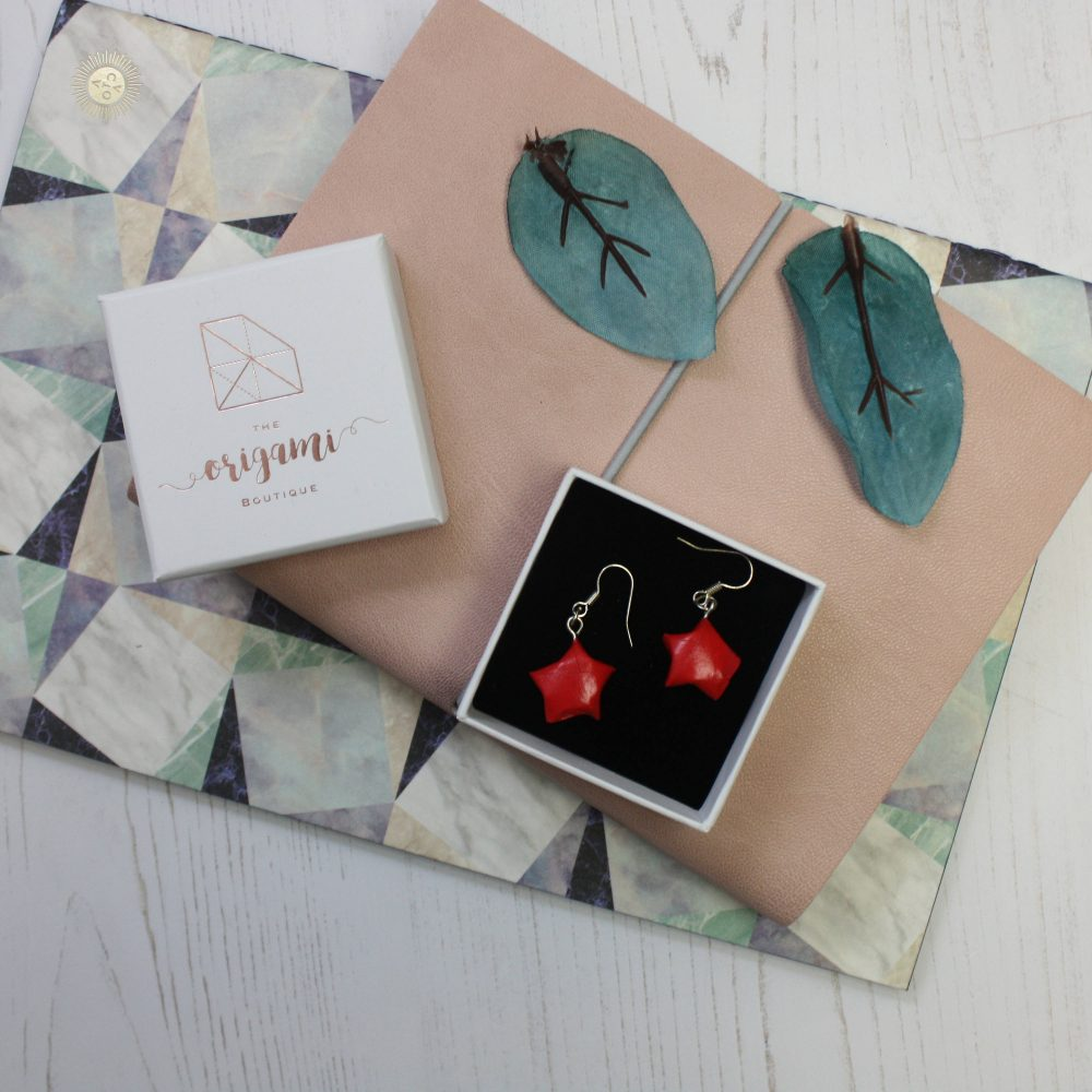 Hanging red star earrings. hand folded by the origami boutique, London. Posted in little presenation box.