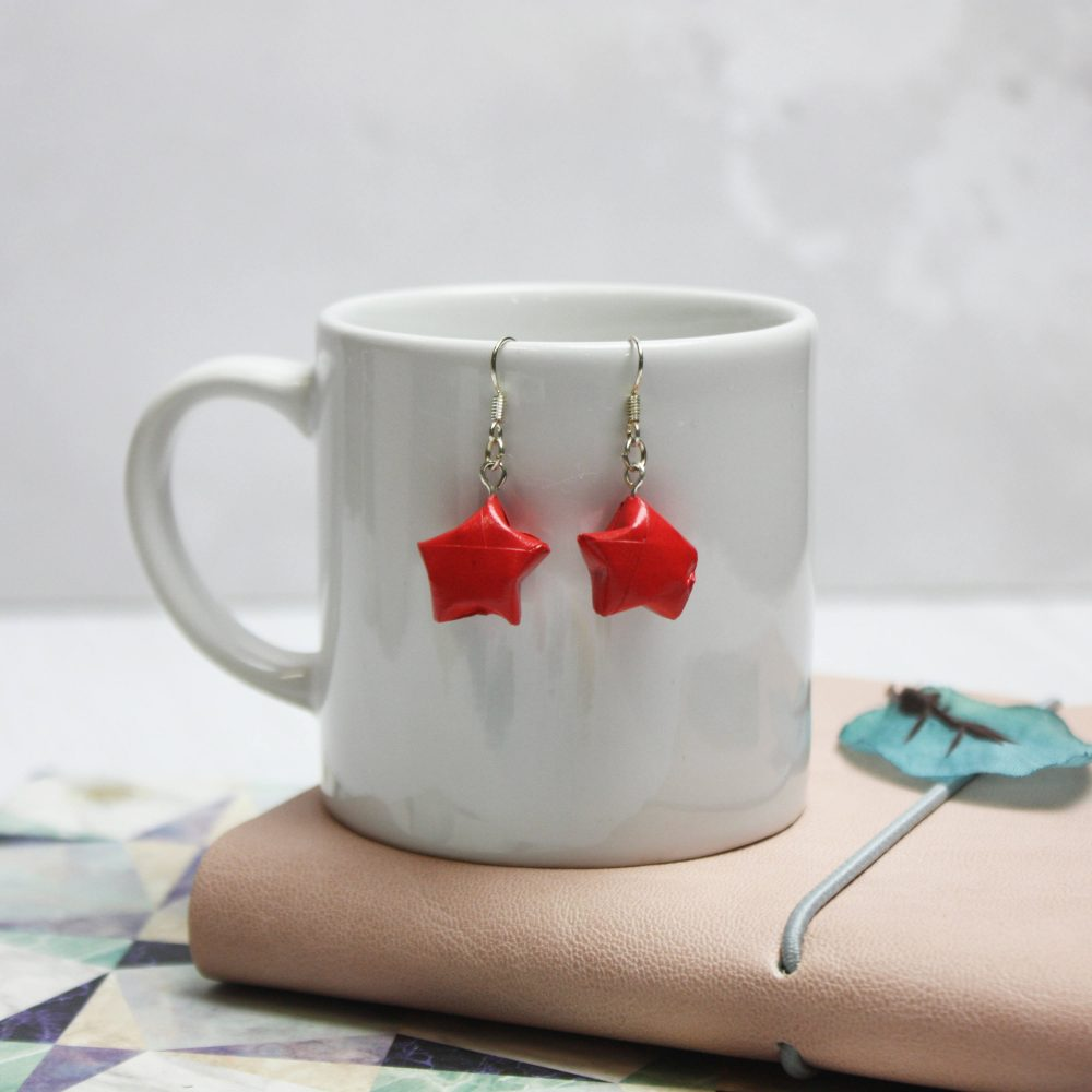 Hanging red star earrings, hand folded by the origami boutique, London.