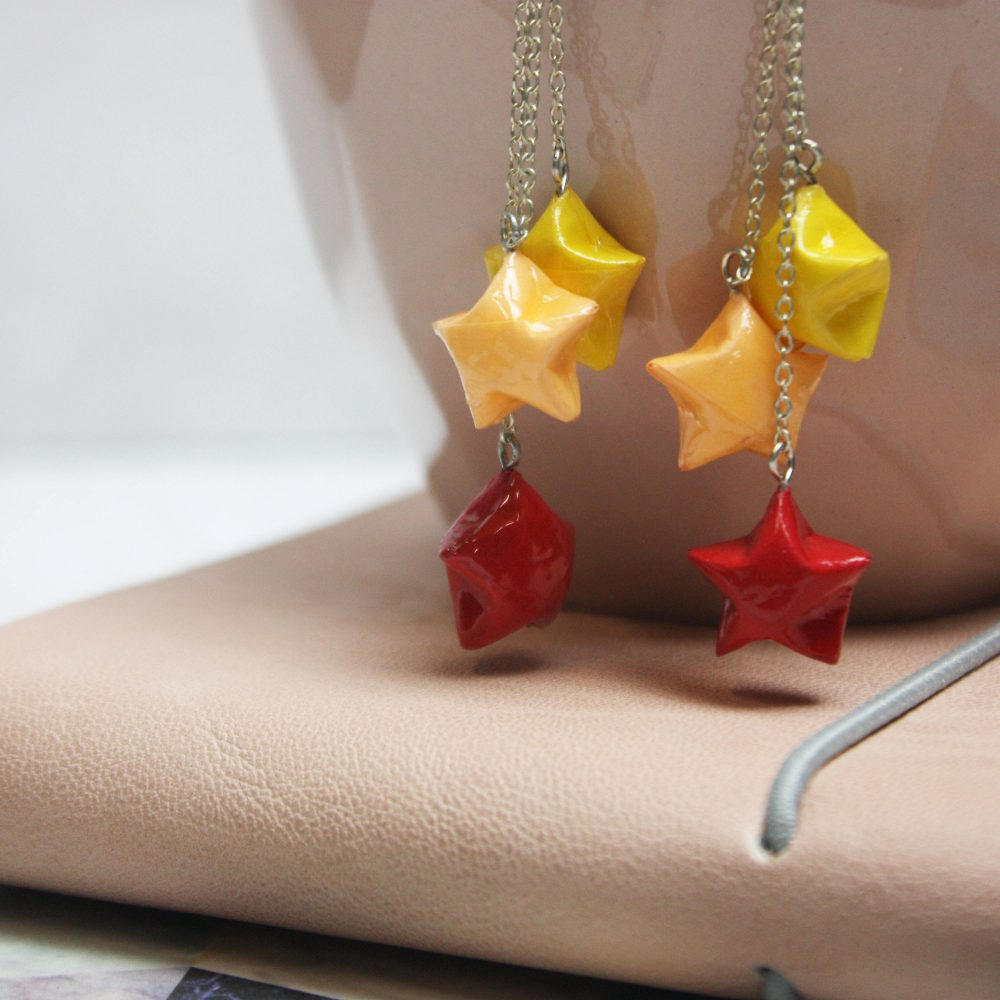 Hanging star earrings, in firey colours, handmade at the origami boutique, london.