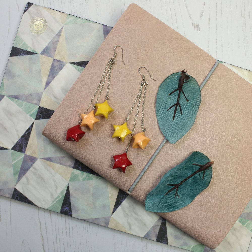 Hanging star origami earrings. Handmade at the origami boutique.