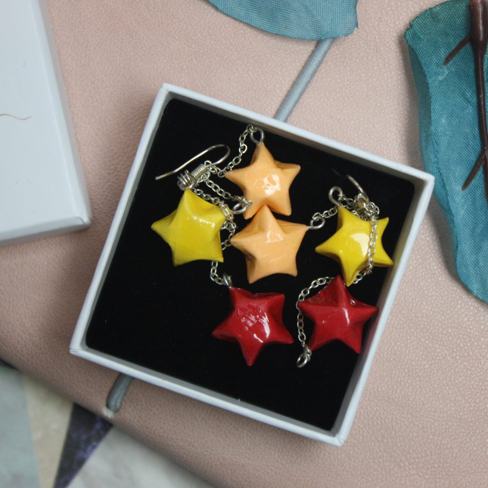 Hanging star earrings in white jewllery box, hand folded in london by the origami boutique.
