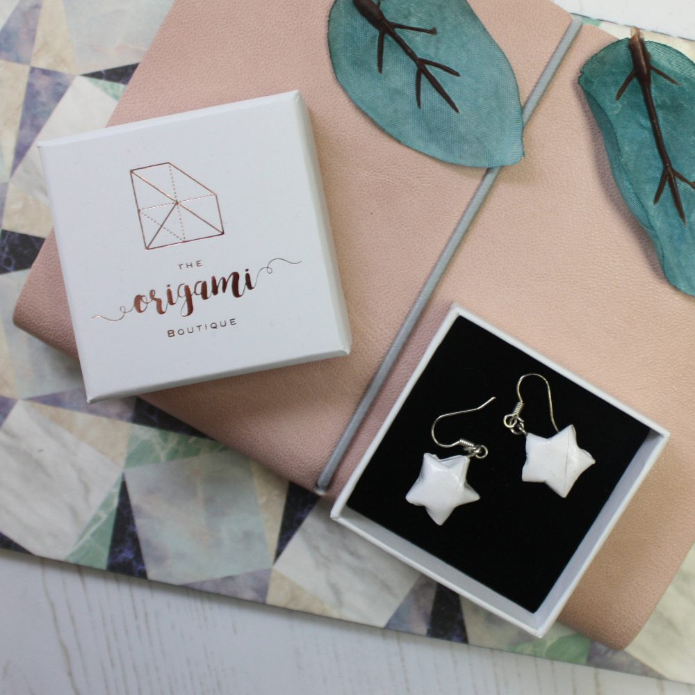 Hanging white origami star earrings. Hand folded by the origami boutique, london. Posted in little presentation box.