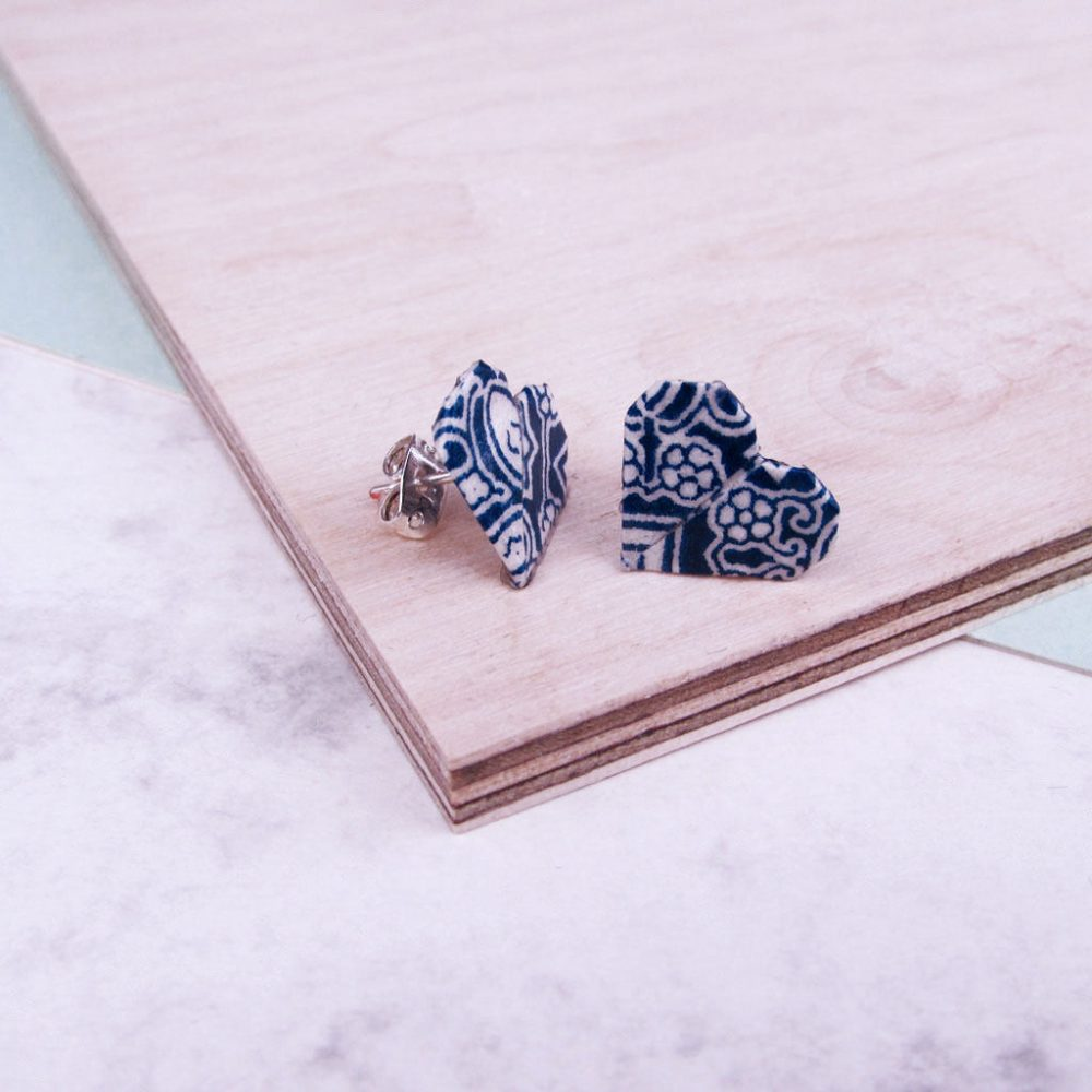 Side view of blue tiles pattern, origami heart earrings. Water resistant and hand folded in London, by the Origami Boutique.