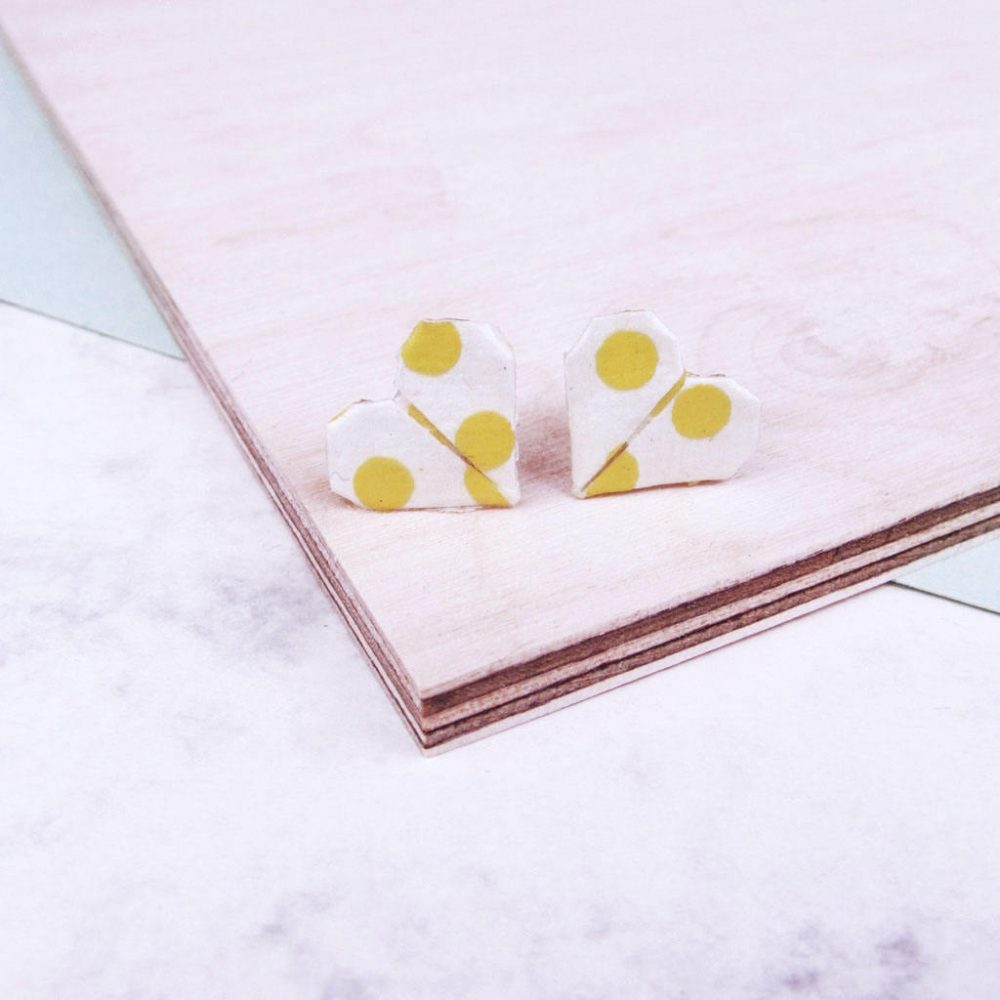 Yellow and white geometric heart earrings.