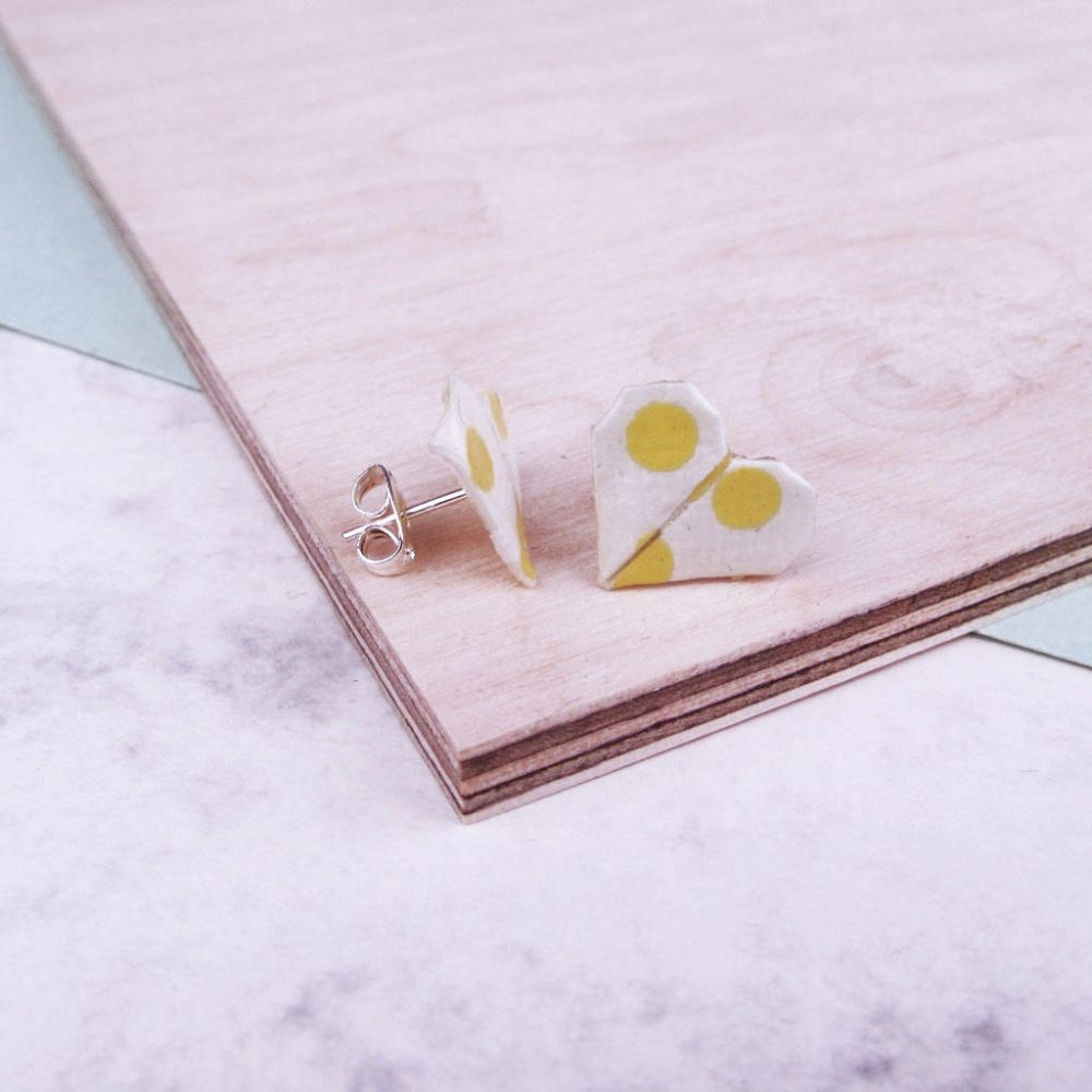 Side view of yellow and white origami stud earrings. The origami boutique london.