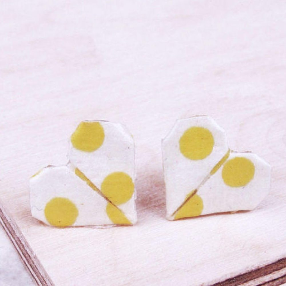 Close up of geometric polkadot stud earrings at the origami boutique, London.