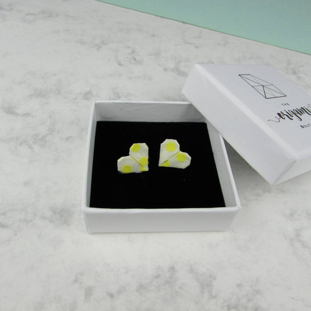 Yellow and white polka dot earrings in white presentation box, by the origami boutique.