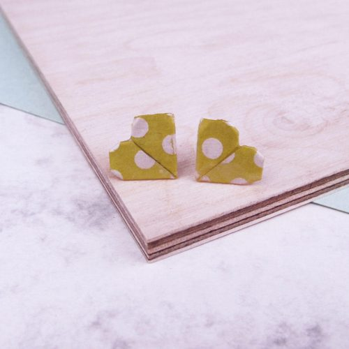 Yellow and white polka dot stud earrings, by the origami boutique, London.