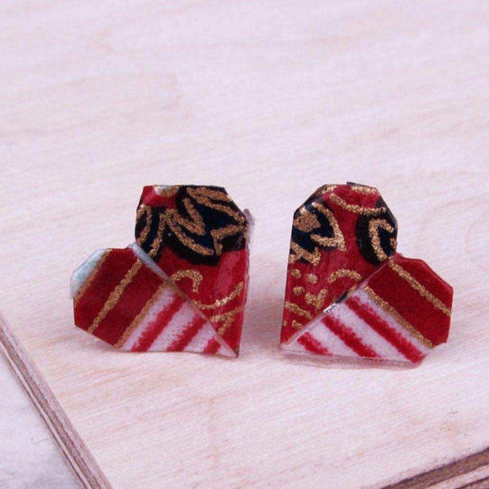 Close up versatile and water resistant, heart folded earrings, in red, white, and gold.