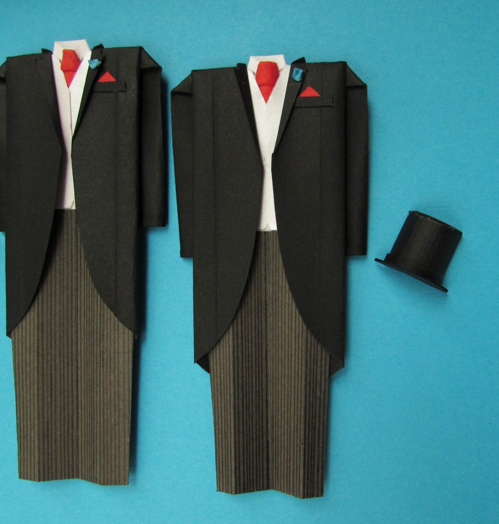 Close up of Mr & Mr origami wedding day outfit by the origami boutique, London.