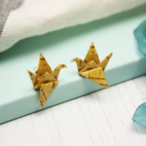 Mustard yellow crane earrings by the origami boutique, London.