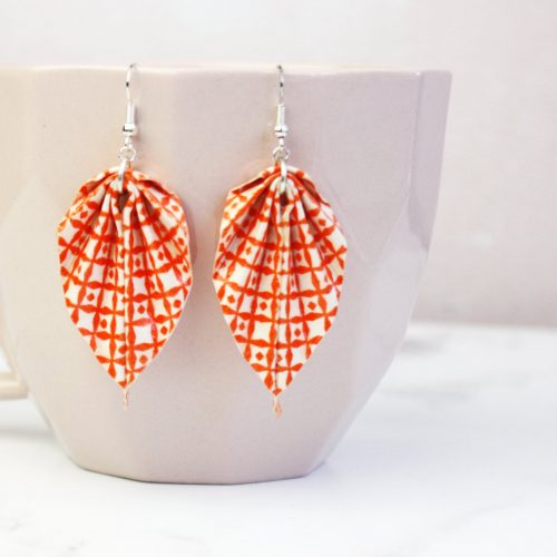 Orange scandi pattern leafe earrings. Water resistant and handmade in london by the origami boutique.