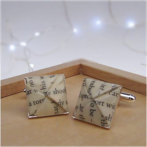 Book pages cufflinks, first wedding anniversary gift option from the origami boutique, London.