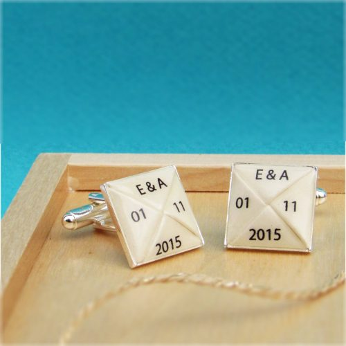 Personalised paper cufflinks, with initials and dates. By the Origami boutique, London.