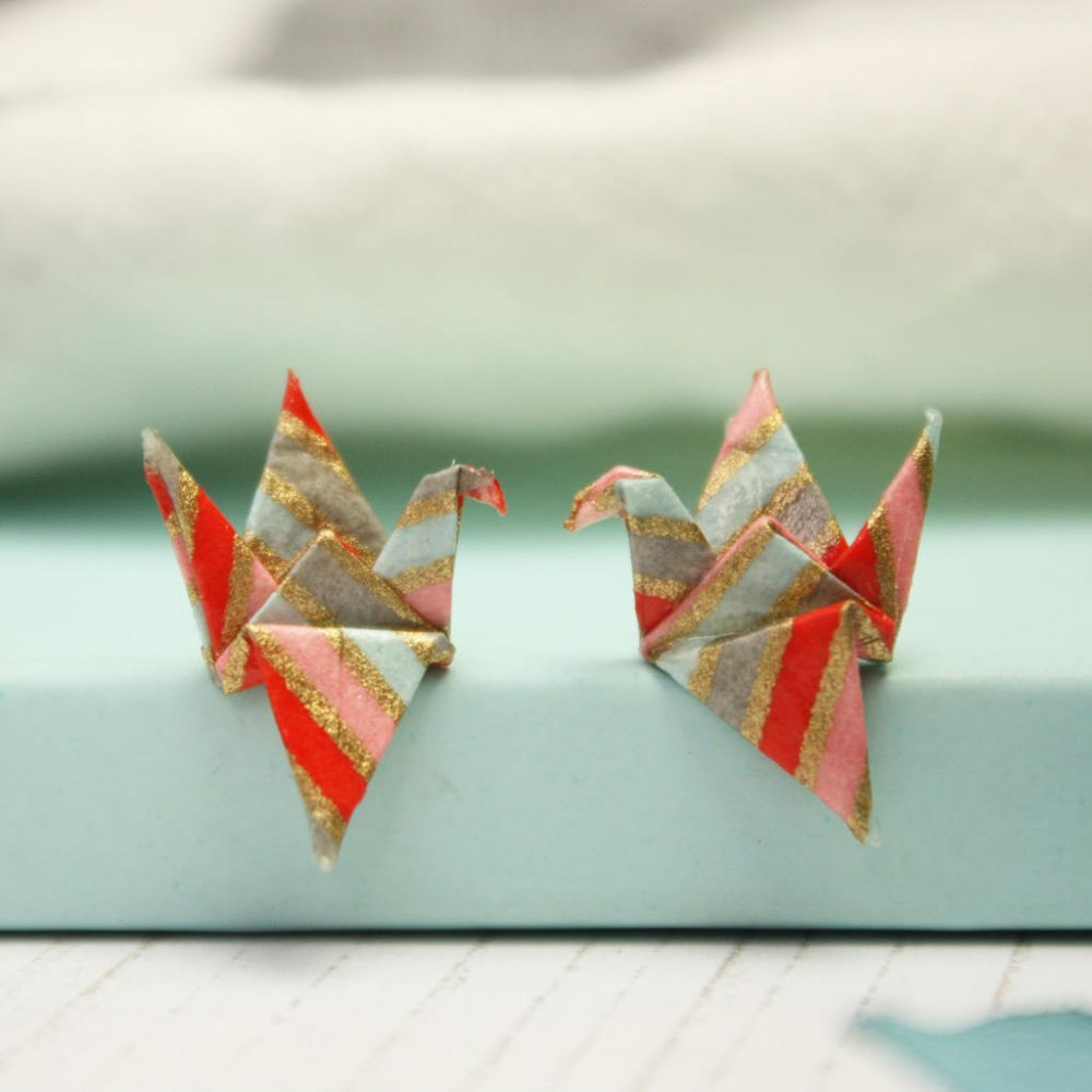 Pink and glitter origami crane earings, by the origami boutique.