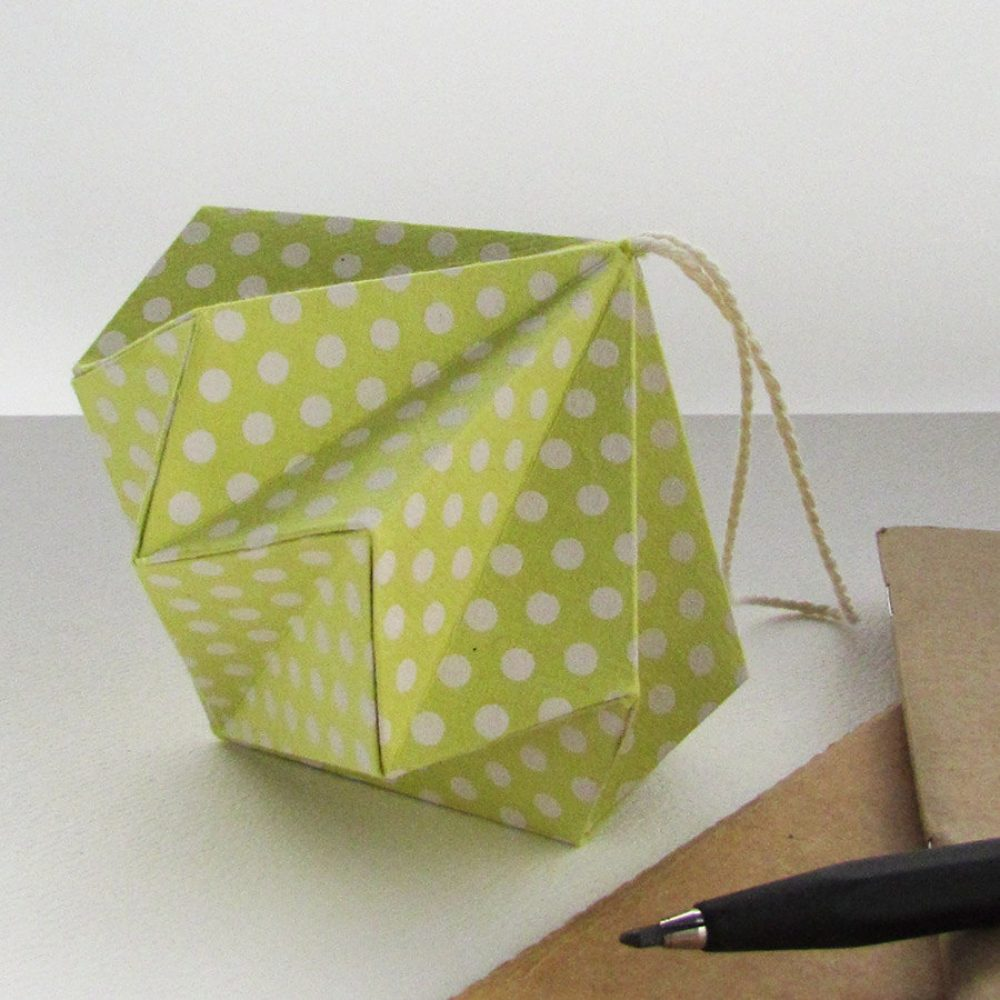 Lime polka dot origami ornament, hand folded by the origami boutique, london.