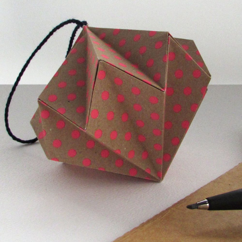 Pink polkadot on kraft, origami ornament/ christmas decoration.